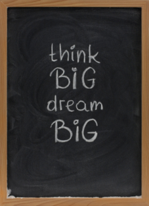 think big, dream big slogan on blackboard